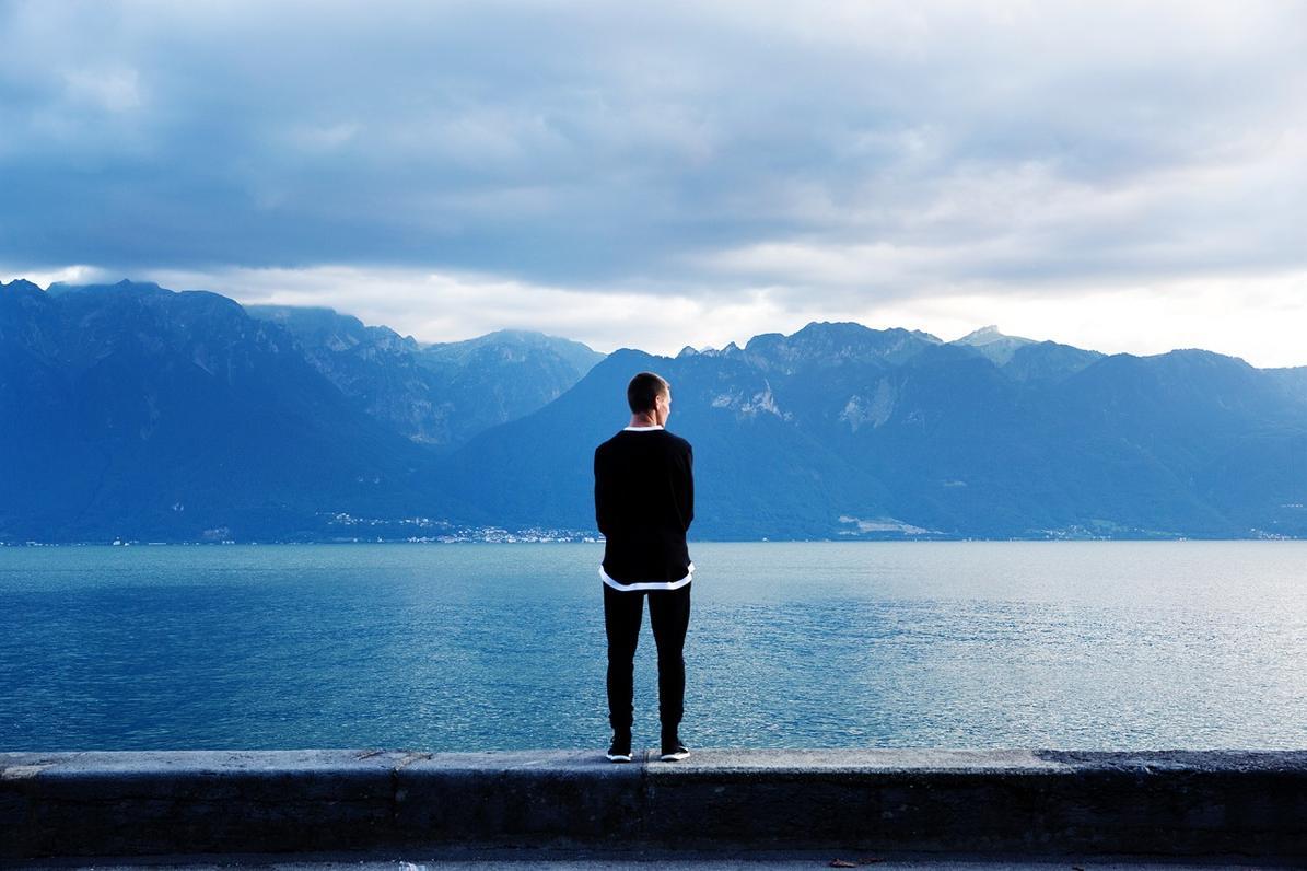 person looking at a lake